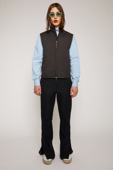 Acne Studios black padded vest is crafted from matte ripstop with a funnel neckline and a front two-way zip and neatly finished with piped trims.