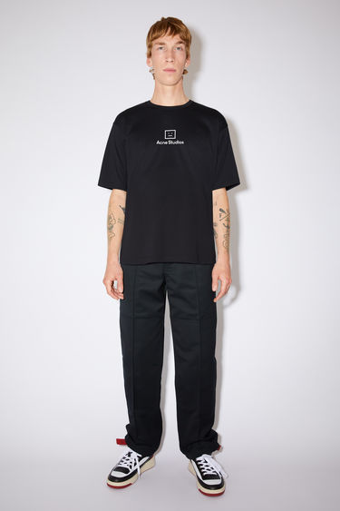 Acne Studios black t-shirt is crafted from lightweight cotton jersey to a relaxed shape with wide elbow-length sleeves and features a reflective face-motif print on front.