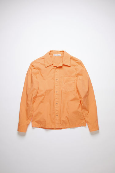 Acne Studios melon orange long sleeve shirt is made of cotton with a boxy, cropped fit.