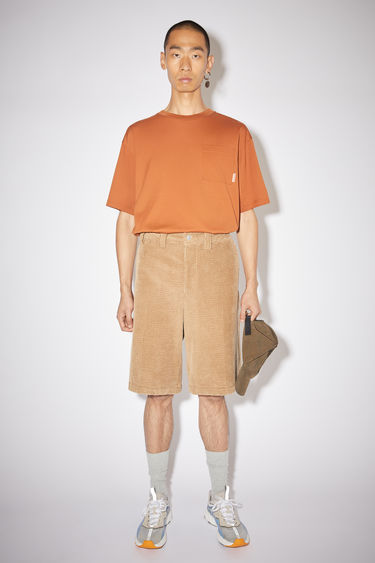 Acne Studios camel brown corduroy shorts have a relaxed fit and are made of a cotton blend.