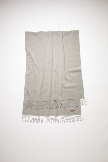 Acne Studios Canada New light grey melange scarf is crafted from pure wool to a wide dimension with fringed edges and set with a label in one corner.