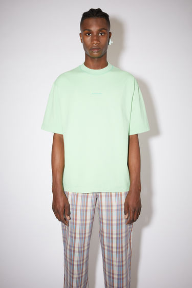 Acne Studios mint green crew neck t-shirt is made of cotton, featuring a front logo print.