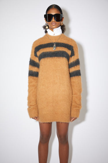 Acne Studios tobacco/charcoal fluffy, striped, crew neck sweater is made of a soft alpaca blend with a relaxed fit.