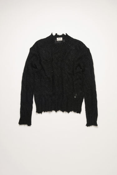 Acne Studios black sweater is loosely knitted in a cable knit pattern and finished with frayed trims.