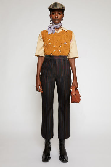 Acne Studios navy orange pinstripe trousers are crafted from wool and are cut to fit slim through the hips before falling into kick-flare legs.