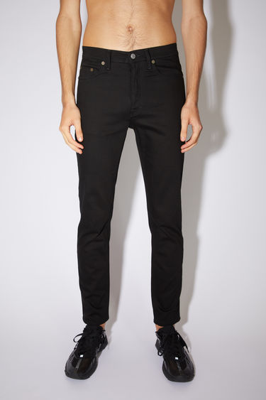 Acne Studios stay black jeans are made from comfort stretch denim with a high rise and a slim, tapered leg.