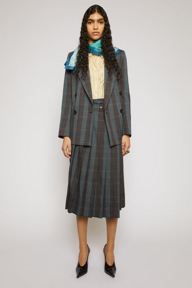 Acne Studios blue/orange skirt is made from a checked wool-blend suiting that's pressed into sharp knife pleats with a wrap-over front and secured with silver snap-button closures.