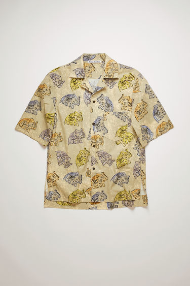 Acne Studio beige short-sleeved shirt is made from lightweight cotton patterned with elephant motifs. It's cut for boxy fit and has an open collar and a chest patch pocket.
