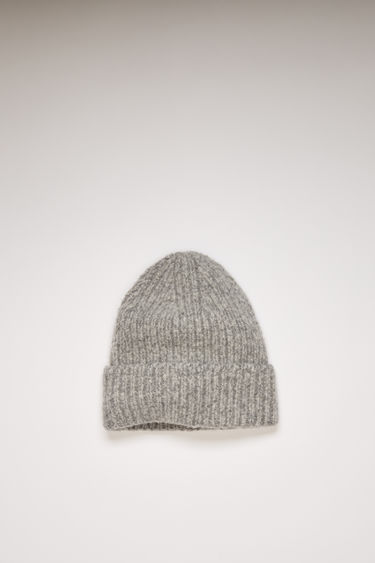 Acne Studios medium grey melange beanie is knitted with melange of wool and cashmere yarns in a chunky ribbed pattern and neatly framed with a turn-up brim.