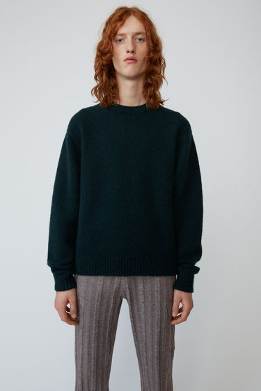 Acne Studios bottle green sweater is knitted from soft wool-blend and completed with a ribbed crew neck, cuffs and hem.
