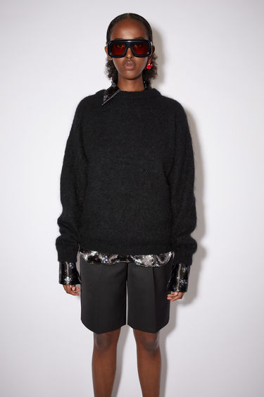 Acne Studios black sweater is knitted from soft wool and mohair-blend yarn and has a ribbed crew neckline and dropped shoulders to create a relaxed silhouette.