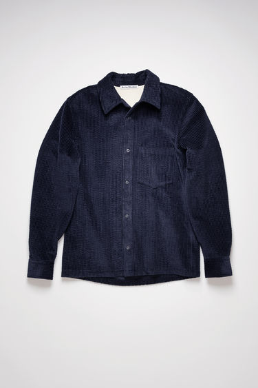 Acne Studios navy shirt is made from wide-ribbed corduroy with a straight hem and has a chest patch pocket and snap buttons through the placket and cuffs.