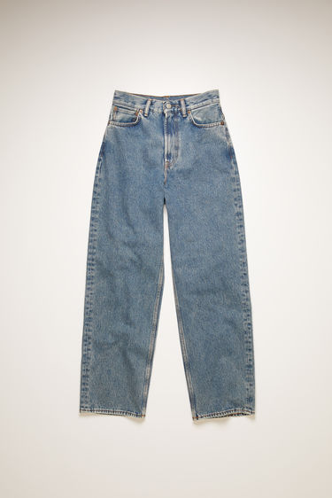 Acne Studios 1993 Blue Pepper jeans are crafted from rigid denim that's stonewashed to give a worn-in appeal. They're cut to relaxed fit, with a super high-rise silhouette that slightly tapers towards the ankle.