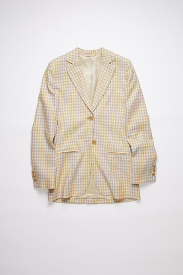 Acne Studios yellow/brown constructed suit jacket is made of a cotton blend tweed with a fitted waist and slightly wide shoulders.