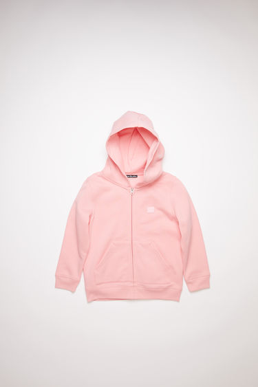 Acne Studios blush pink hooded sweatshirt is made of organic cotton with a face logo patch and ribbed details.