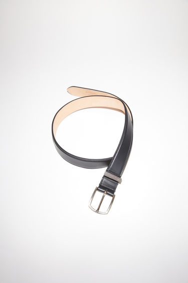 Acne Studios black classic belt is made of matte calf leather.
