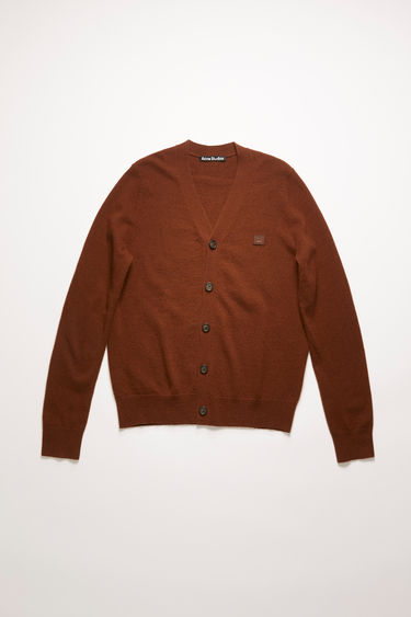 Acne Studios dark brown cardigan is knitted with a fine gauge from soft wool yarns and accented with a tonal face-embroidered patch on the chest.