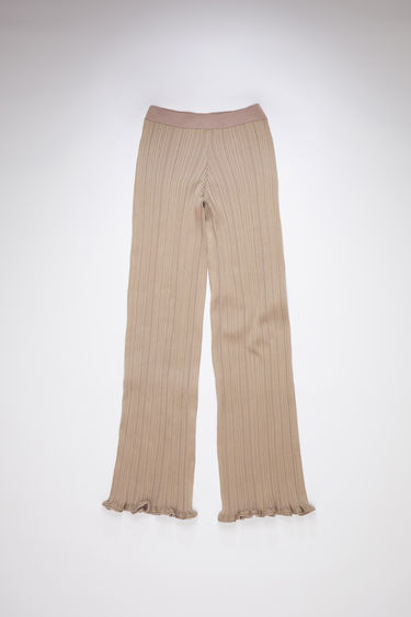 Acne Studios taupe beige irregular rib casual trousers have an elastic waistband and a classic fit.