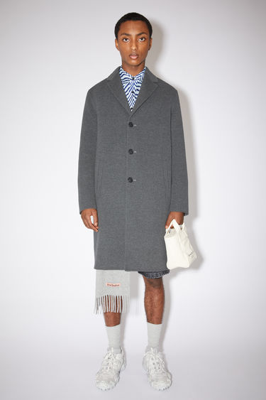 Acne Studios dark grey melange double face coat is made of wool with two side pockets.