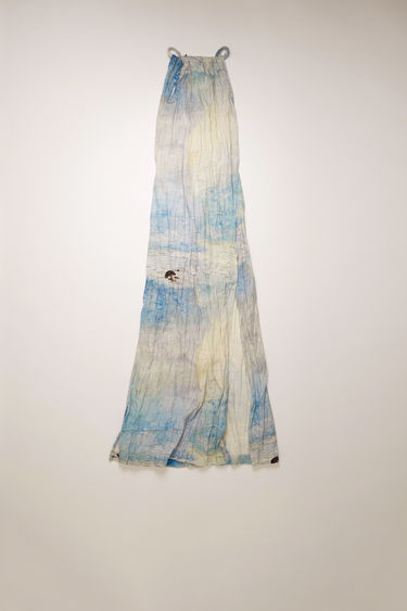 Acne Studios blue/white apron dress is crafted from crinkled linen and features a painting of Swedish nature by August Strindberg. It's shaped with a gathered halter neck which secures with twisted ties that cross-over the open back.