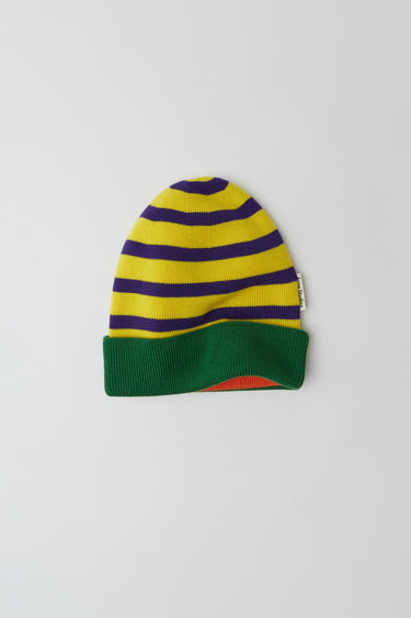 Acne Studios launches an exclusive range with Swedish artist Jacob Dahlgren. As part of the collaboration, the yellow multi beanie is finely knitted from wool and patterned with horizontal stripes.