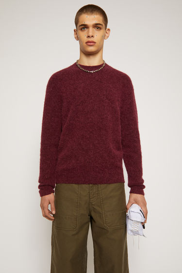 Acne Studios burgundy sweater is knitted from soft alpaca and wool-blend yarn that's brushed for a fuzzy finish and neatly finished with ribbed trims along the neckline, cuffs and hem.