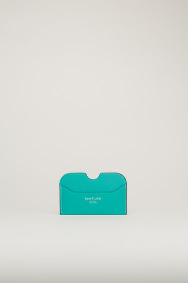 Acne Studios Elmas S turquoise blue cardholder is crafted from soft grained leather with three card slots and accented with a cut-out at the midpoint of the central slot.