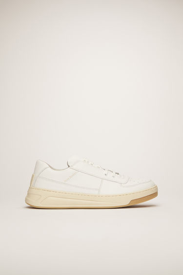 Acne Studios Perey Lace Up white/white sneakers are crafted from smooth calf leather and shaped to a round toe with a low-top silhouette.