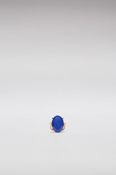 Acne Studios blue ring is crafted from gold-tone brass to a slim band and embellished with an oval-shaped faceted stone.