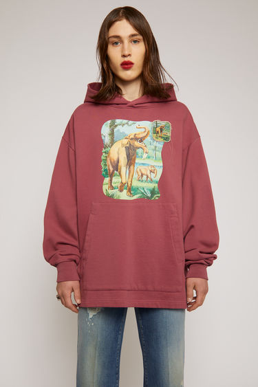 Acne Studios old pink hooded sweatshirt features an elephant print and a patch adorned on the front. It's crafted from organically grown cotton to an oversized fit enhanced with dropped shoulders and an exaggerated kangaroo pocket.