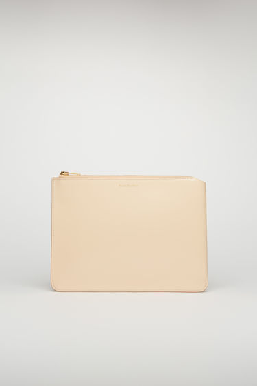 Acne Studios blush pink document holder is crafted from high-shine leather and accented with a gold-tone zip closure and foil branding on the front.
