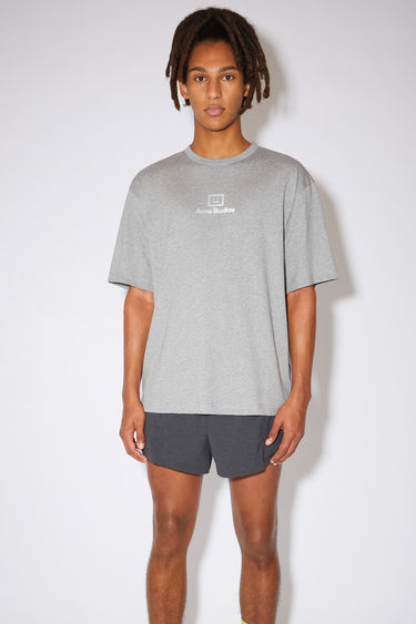 Acne Studios light grey melange t-shirt is crafted from lightweight cotton jersey to a relaxed shape with wide elbow-length sleeves and features a reflective face-motif print on front.