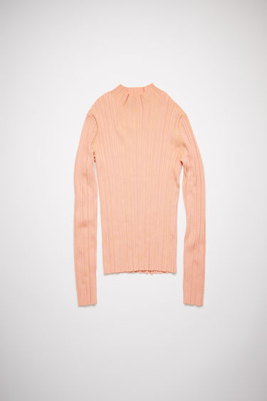 Acne Studios salmon pink irregular rib knit sweater has a mock neck with a fitted, elongated silhouette.