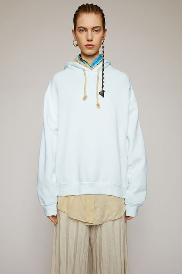 Acne Studios ice blue hooded sweatshirt is cut from brushed cotton jersey to an oversized fit and has a logo tab sewn on the side seam.