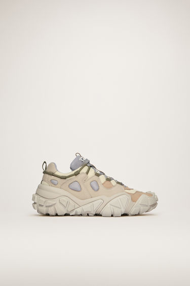 Acne Studios Bolzter W desert beige sneakers are crafted from mesh with faux-suede overlays, and set on chunky tread soles.