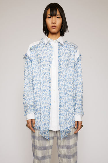 Acne Studios blue/white shirt is crafted from cotton-poplin with a point collar and a centre button-down closure. It's overlayed with a raw-edged crinkled chiffon that's patterned with a floral motif.