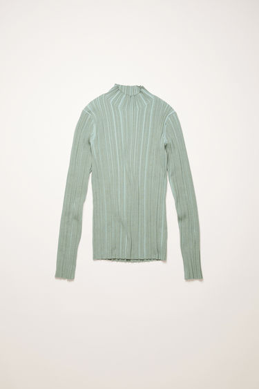Acne Studios dusty green mock neck sweater is knitted from mercerized cotton with an irregular ribbed pattern and has a slim-fitting profile.