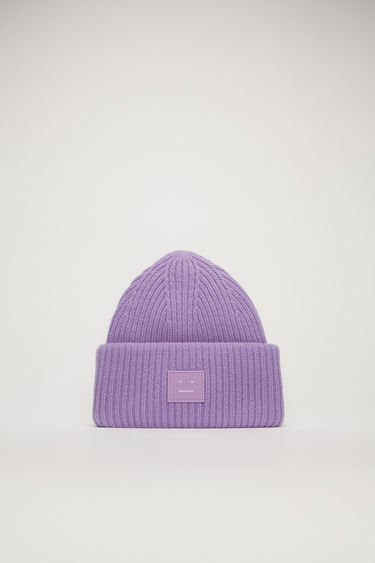 Acne Studios lavender purple beanie is rib-knitted from soft wool and accented with a face-embroidered patch on the front.