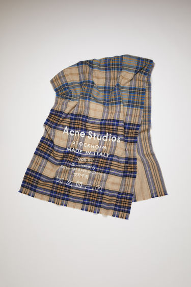 Acne Studios Cassiar Check oatmeal beige/blue is an oversized, checked scarf with printed branding.