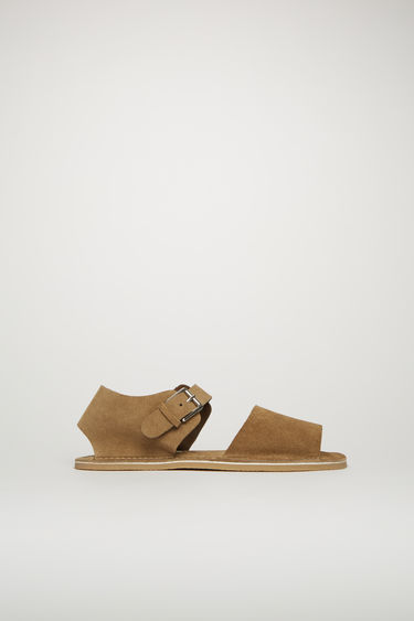 Acne Studios beige sandals take design cues from the classic Menorcan shoes. They're crafted with wide suede straps accented by logo-woven tabs, then set on a crepe-rubber sole.