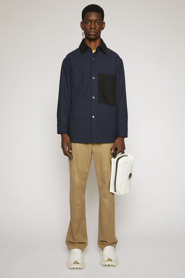 Acne Studios navy/black chore jacket is cut to a boxy shape from a wool blend with checks and accented with contrasting collar, chest pocket and elbow patches.