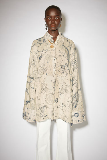 Acne Studios ecru beige long sleeve shirt is made of printed linen with a relaxed fit.