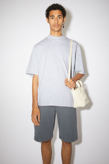 Acne Studios pale grey melange t-shirt is cut to a boxy fit from soft cotton jersey and shaped with a mock neck and short sleeves.