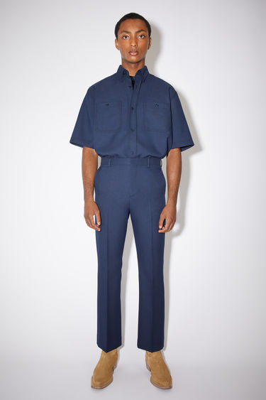 Acne Studios spruce blue tailored trousers are made of polyester twill with a slight flare
