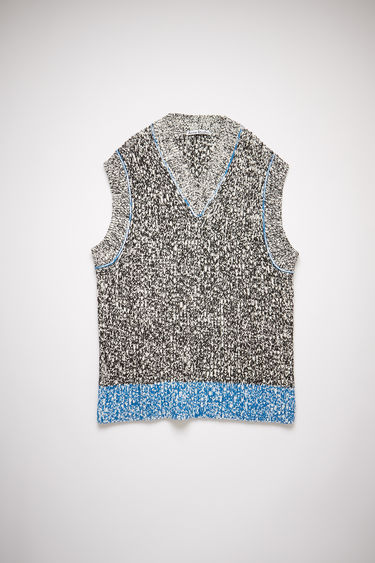 Acne Studios white/black chunky sweater vest has an oversized fit and contrasting bottom hem.