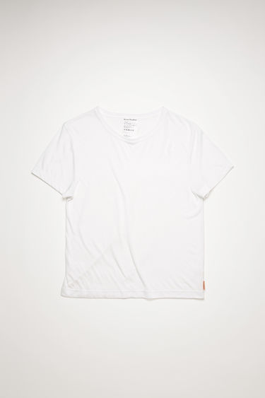 Acne Studios optic white t-shirt is cut from a lightweight jersey with a round neck and has a small logo-jacquard tab sewn on the side seam.