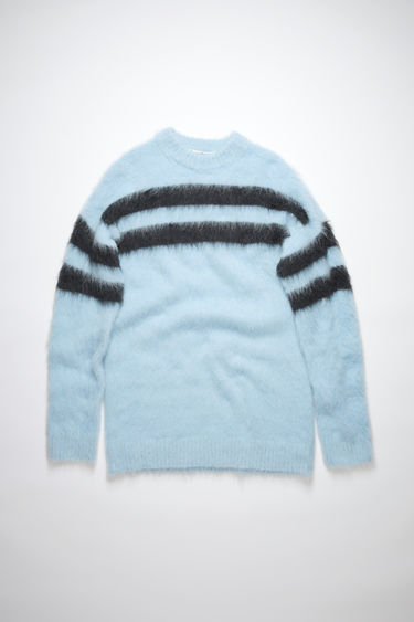 Acne Studios light blue/charcoal fluffy, striped, crew neck sweater is made of a soft alpaca blend with a relaxed fit.