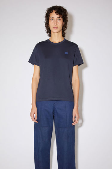 Acne Studios navy crew neck t-shirt is made from cotton with a regular fit and a face logo patch.