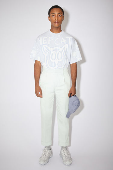 Acne Studios pale green casual structured trousers are made of a cotton blend with a slight stretch and a tapered fit.