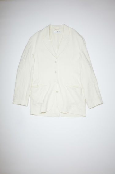 Acne Studios ivory white oversized, single-breasted suit jacket features decorative tie details.